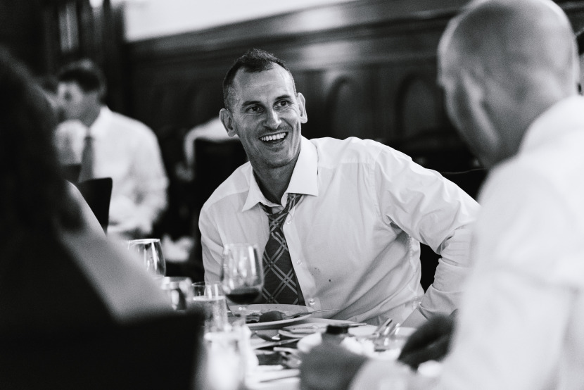 wedding-guest-laughing-at-table
