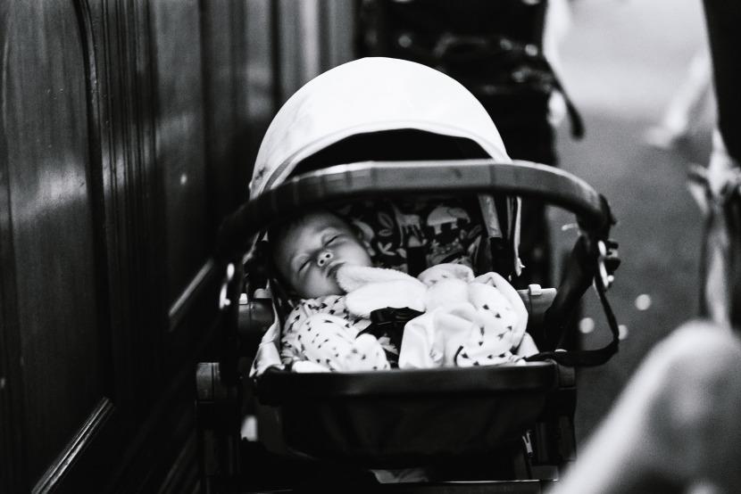 young-baby-sleeping-in-buggy