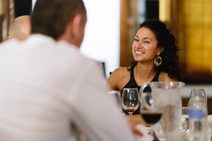 woman-laughing-sat-at-wedding-table