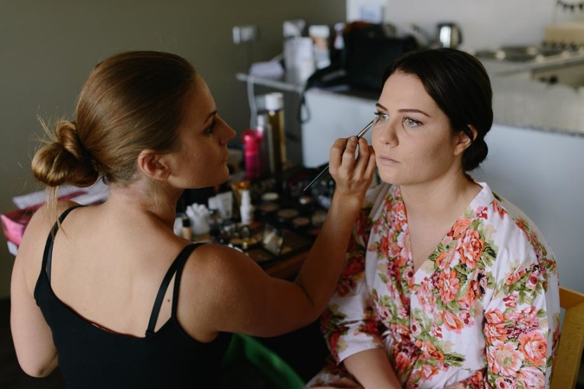 bride-having-wedding-make-up-applied