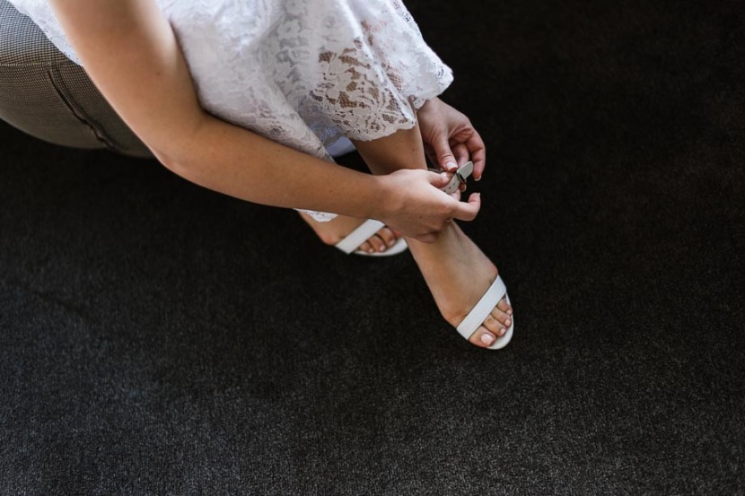 bride-tying-wedding-shoes