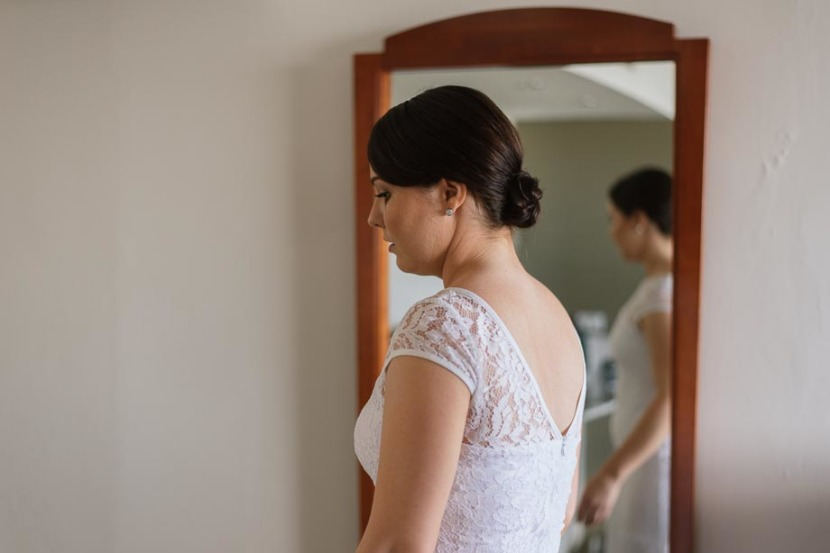 bride-in-wedding-dress-at-mirror