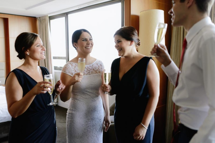 bridesmaids-laughing-drinking-champagne