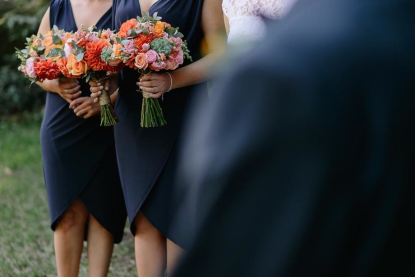 bridesmaids-holding-wedding-flowers