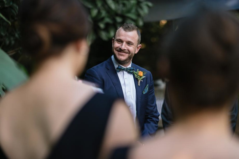 man-smiling-during-wedding-ceremony