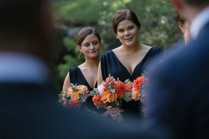 bridesmaids-smiling-during-wedding-ceremony