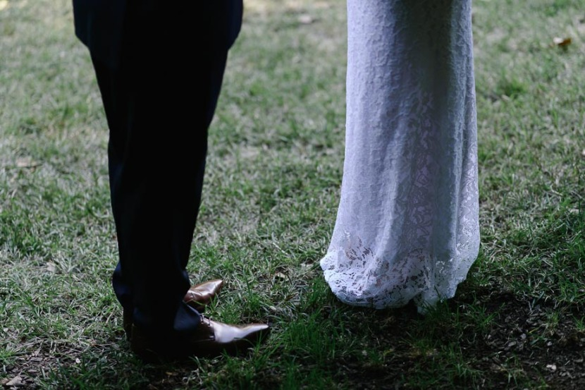 grooms-shoes-and-brides-wedding-dress
