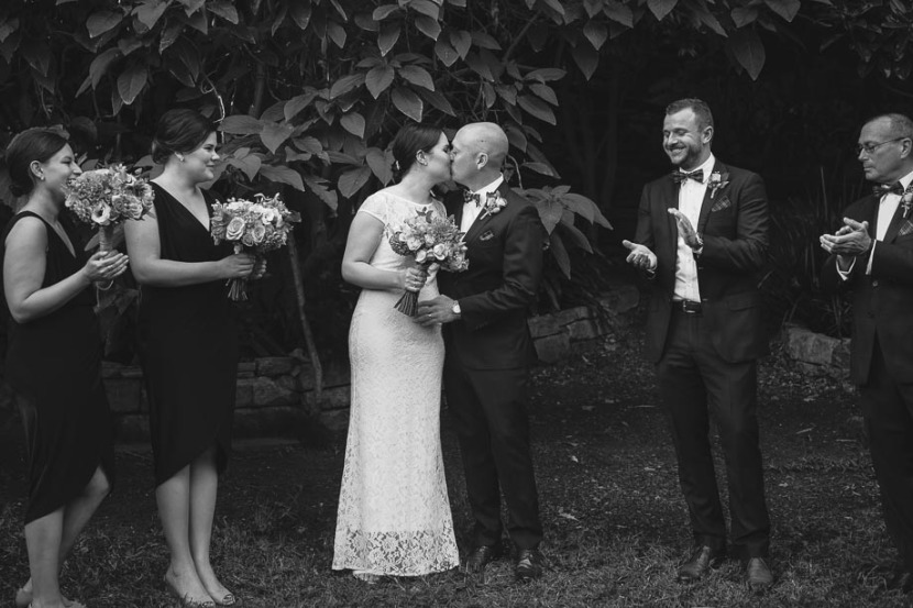 bride-groom-kissing-after-wedding-ceremony