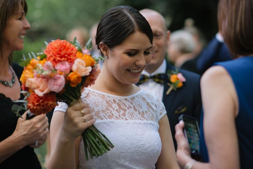 bride-smiling-holding-wedding-flowers