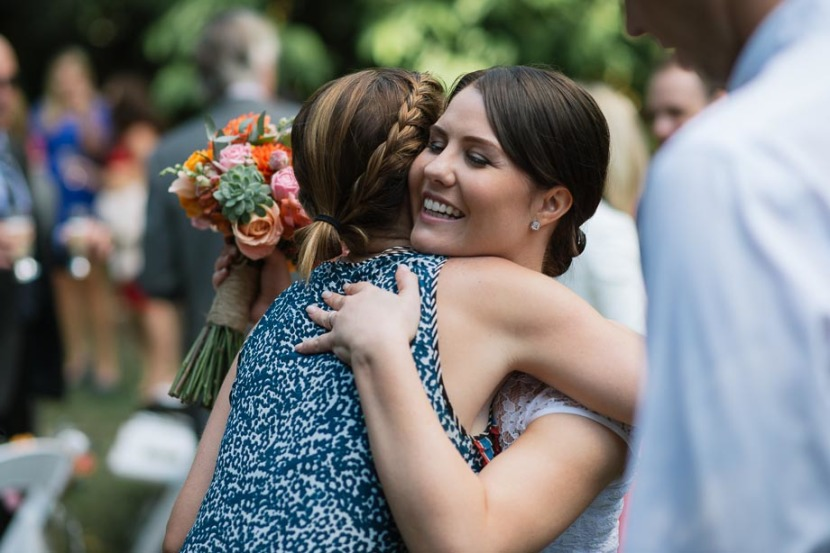 bride-hugging-woman-after-wedding