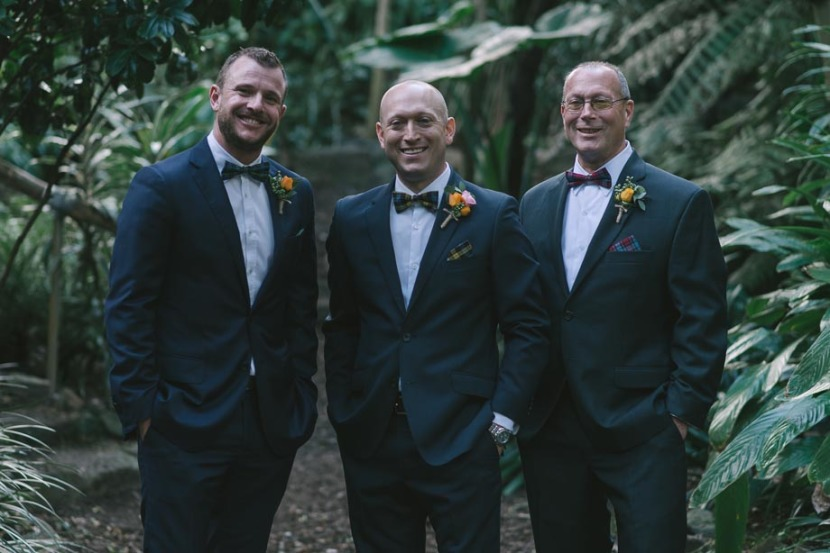 groomsmen-and-groom-in-trees