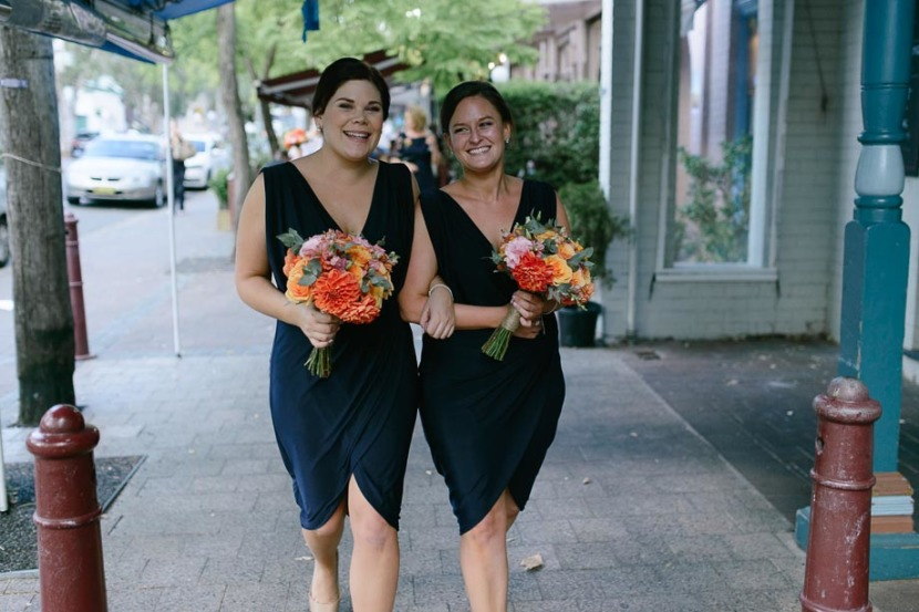 bridesmaids-laughing-walking-down-street
