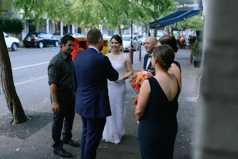 wedding-party-standing-in-street