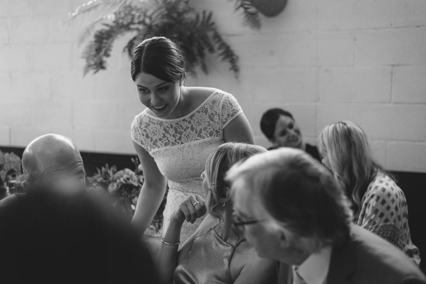bride-laughing-with-wedding-guest