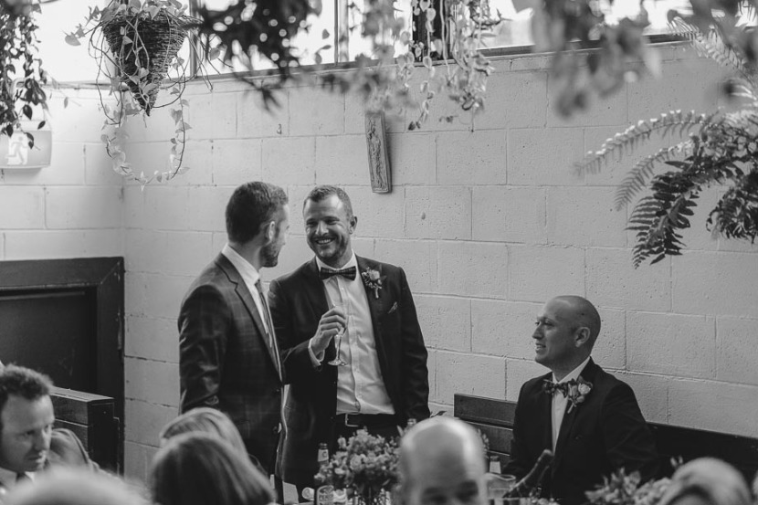 men-laughing-at-wedding-reception