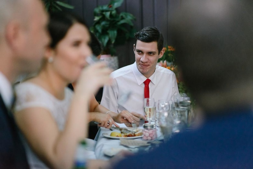 man-sitting-at-wedding-table