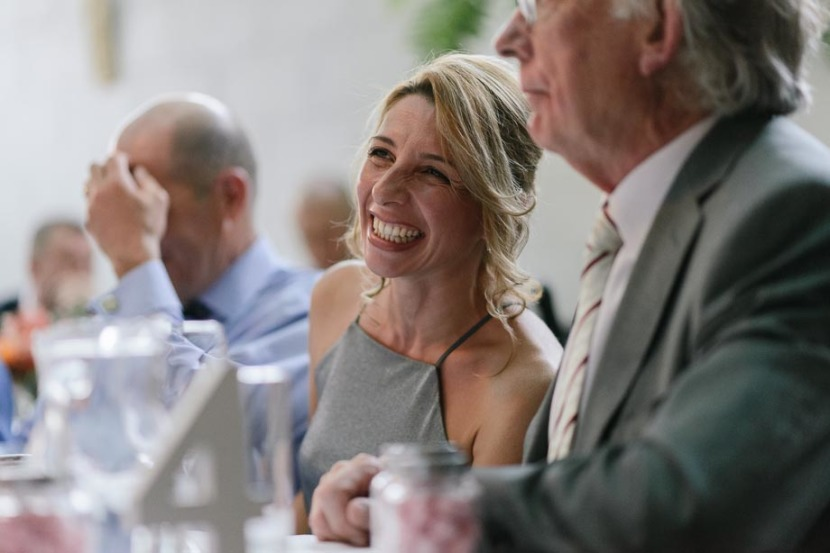 woman-smiling-at-wedding-reception