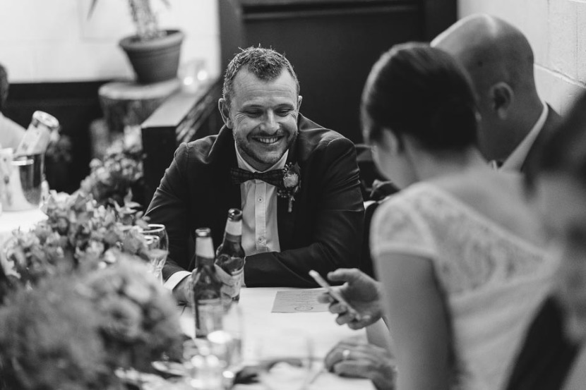 man-smiling-at-wedding-reception