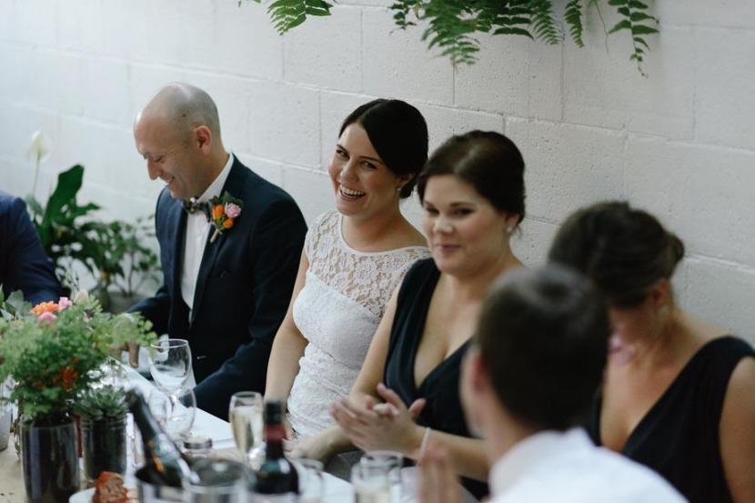 bride-smiling-at-wedding-table