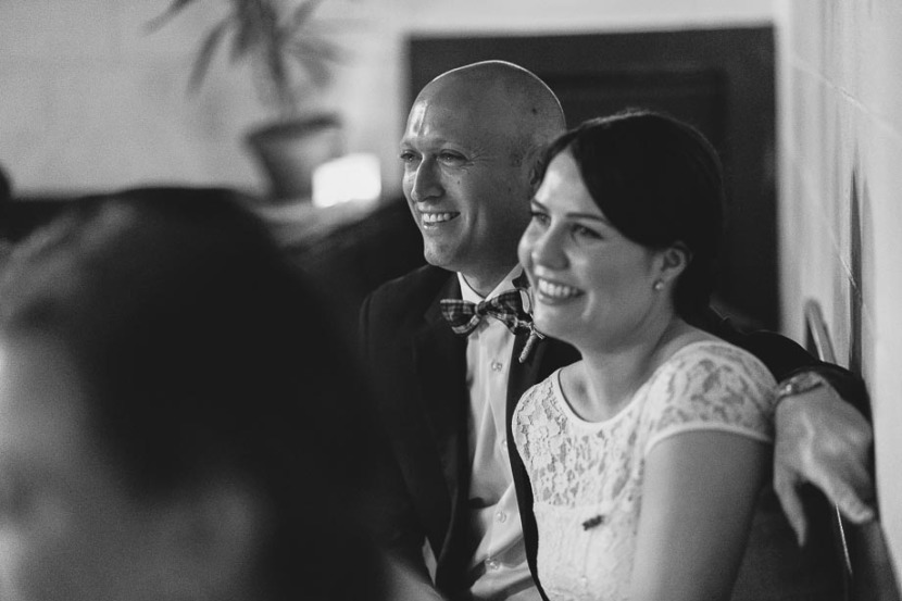 bride-groom-laughing-during-wedding-speech