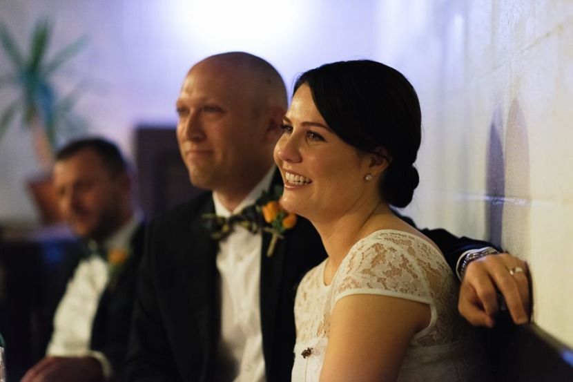 bride-smiling-during-wedding-speech