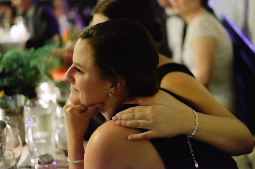 bridesmaids-hugging-during-wedding-speeches