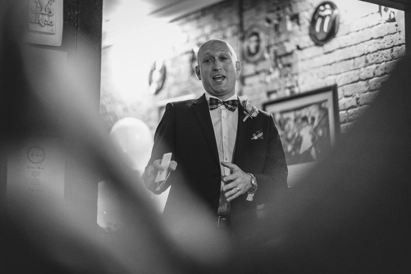 groom-standing-making-wedding-speech
