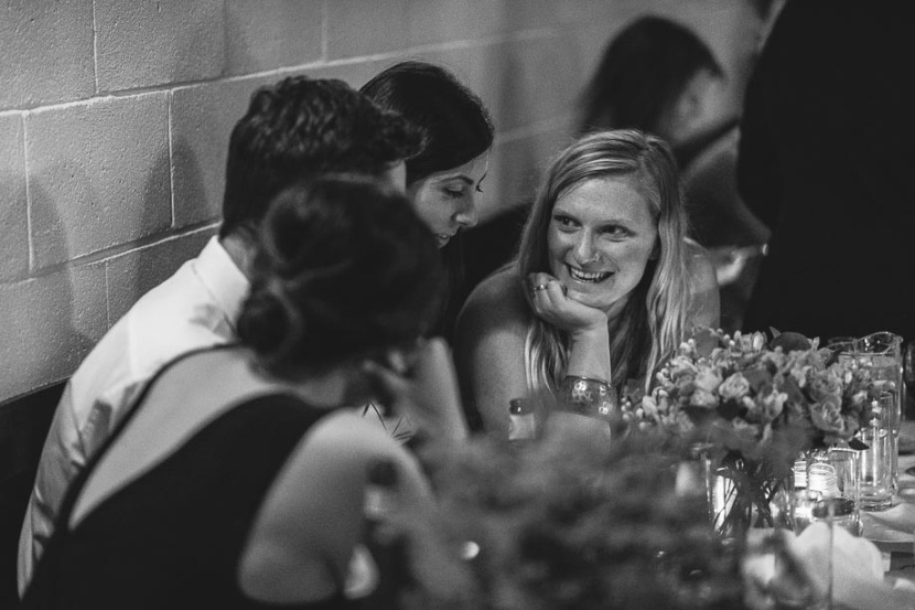 girl-laughing-and-talking-at-wedding