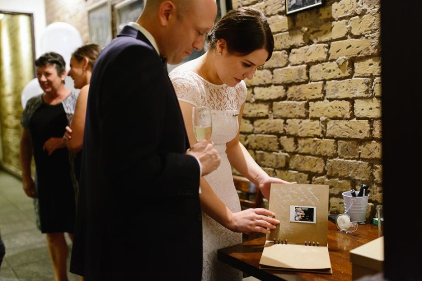 bride-groom-reading-wedding-guest-book