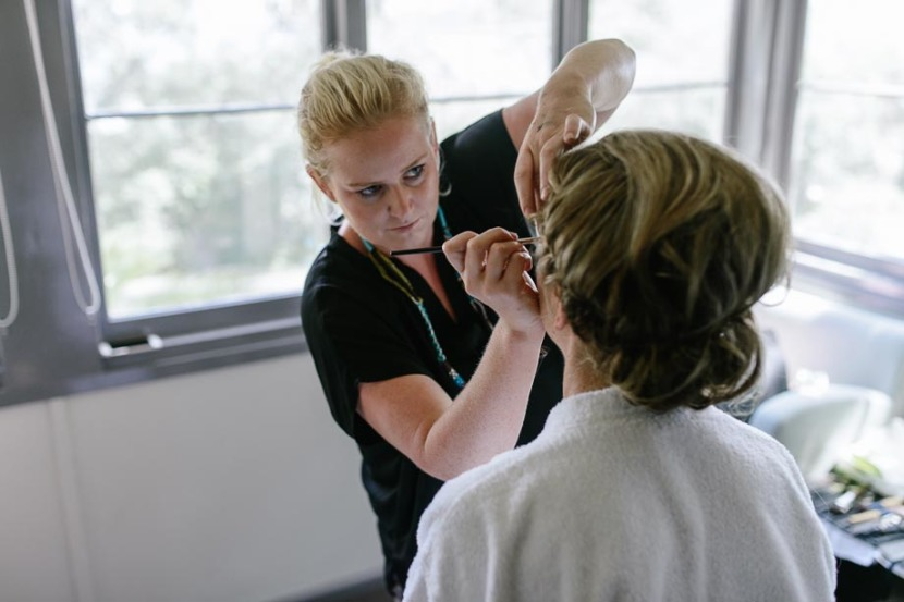 bride-having-wedding-make-up-done