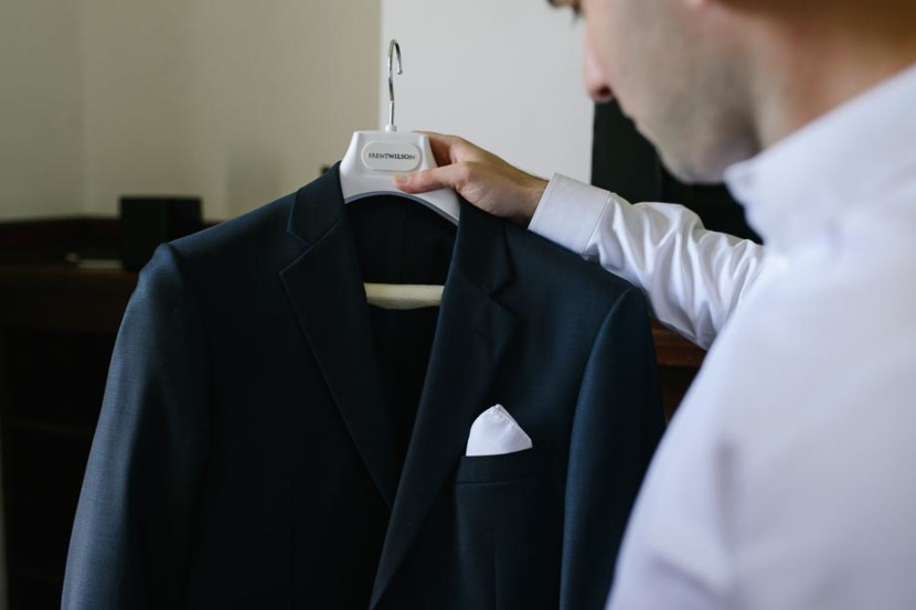 groomsman-holding-wedding-jacket
