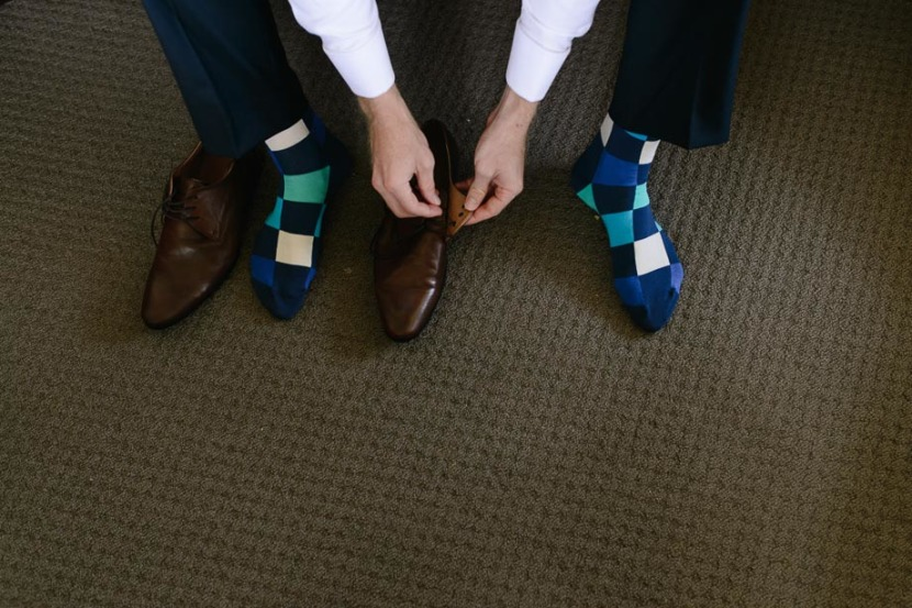 groom-putting-on-wedding-shoes