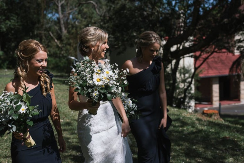 bride-and-bridesmaids-walking-in-trees