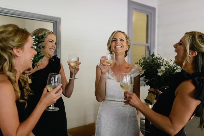 bride-pouring-bridesmaid-champagne