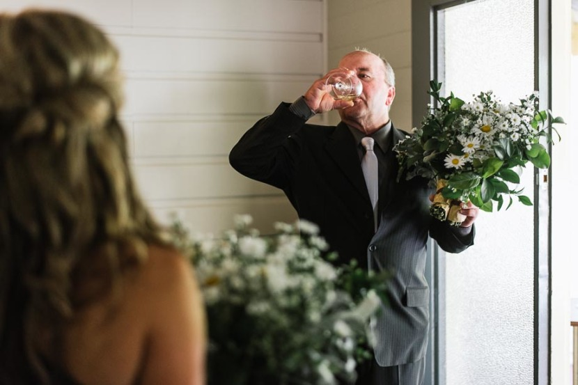 brides-father-drinking-glass-champagne