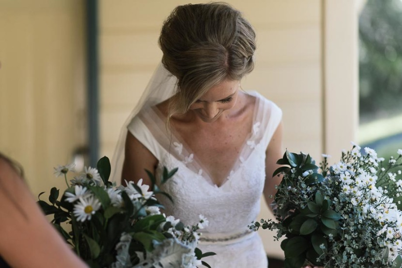 bride-in-wedding-dress-and-holding-flowers