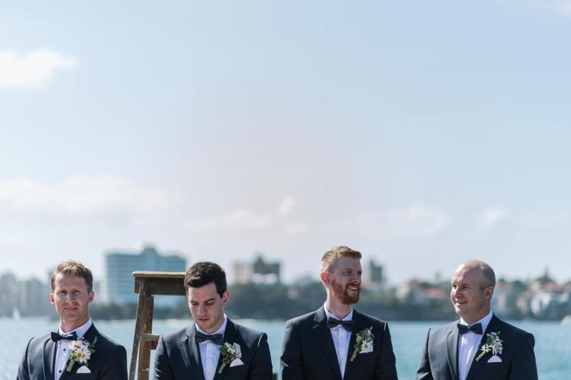 groom-and-groomsmen-on-q-station-wharf