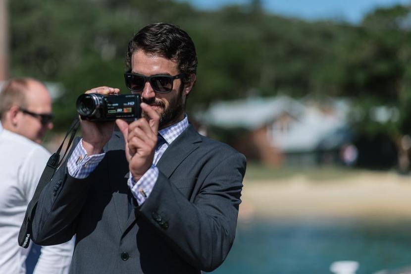 man-videoing-manly-wedding