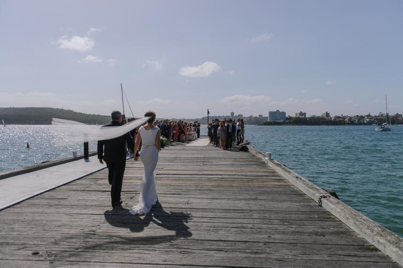 bride-walking-down-wharf-q-station