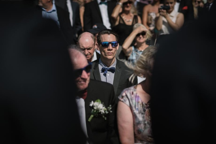 man-in-sunglasses-during-wedding-ceremony