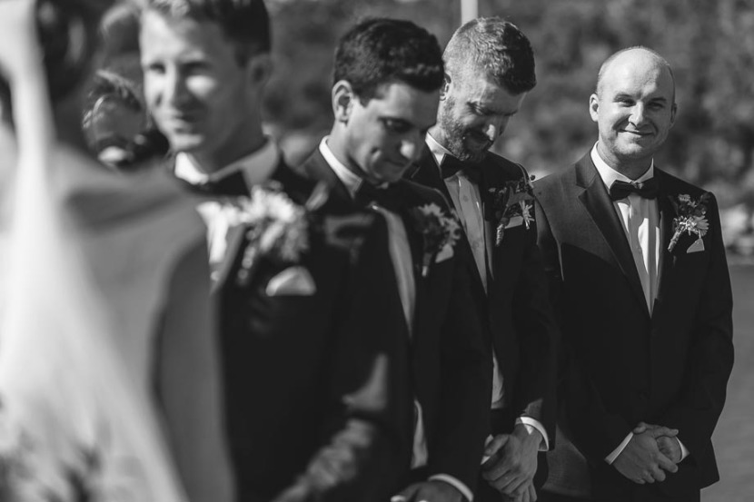 smiling-groomsman-during-wedding-ceremony
