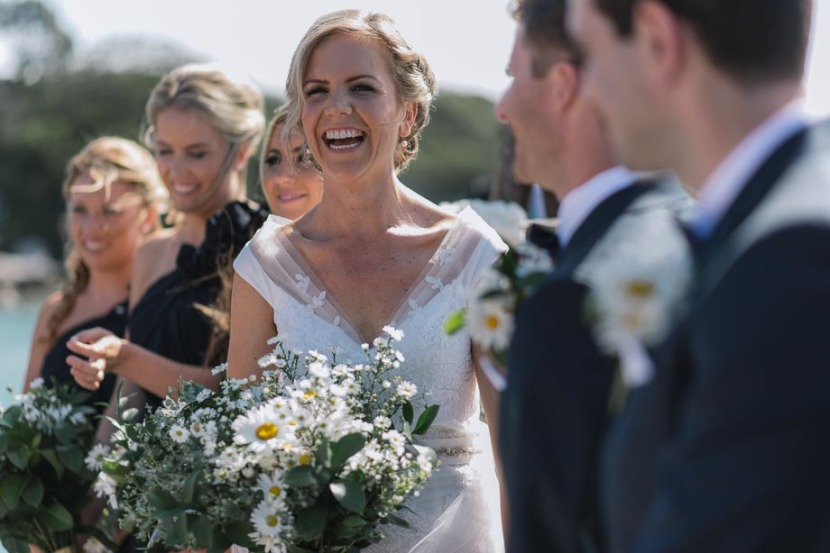 bride-laughing-during-wedding-vows