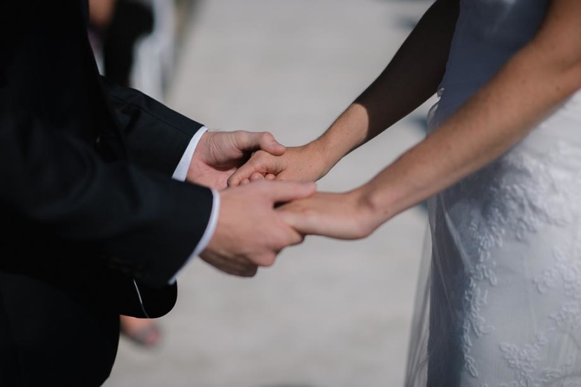 bride-groom-holding-hands-during-wedding-vows