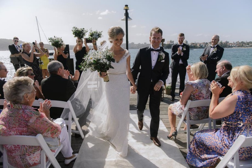 bride-groom-walking-down-ailse-q-station-wharf
