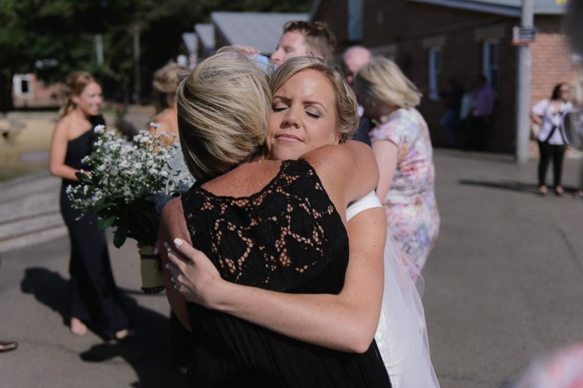 bride-hugging-mother-after-wedding