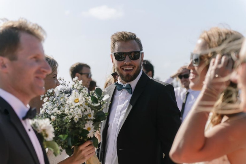 wedding-guest-laughing-in-sunglasses