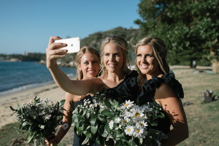 bridesmaids-taking-selfie-on-the-beach