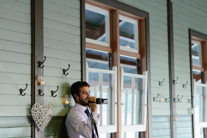 man-taking-video-during-wedding-reception