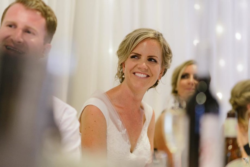 bride-laughing-during-wedding-speeches