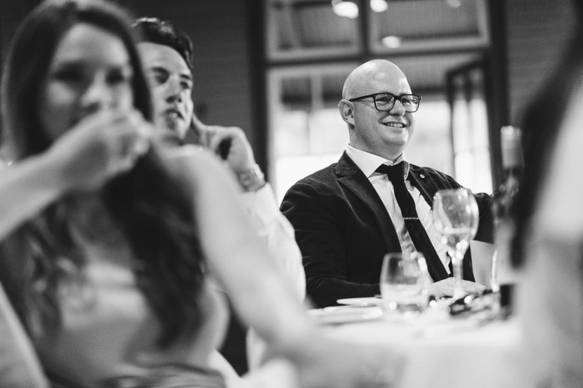 man-laughing-during-wedding-speeches
